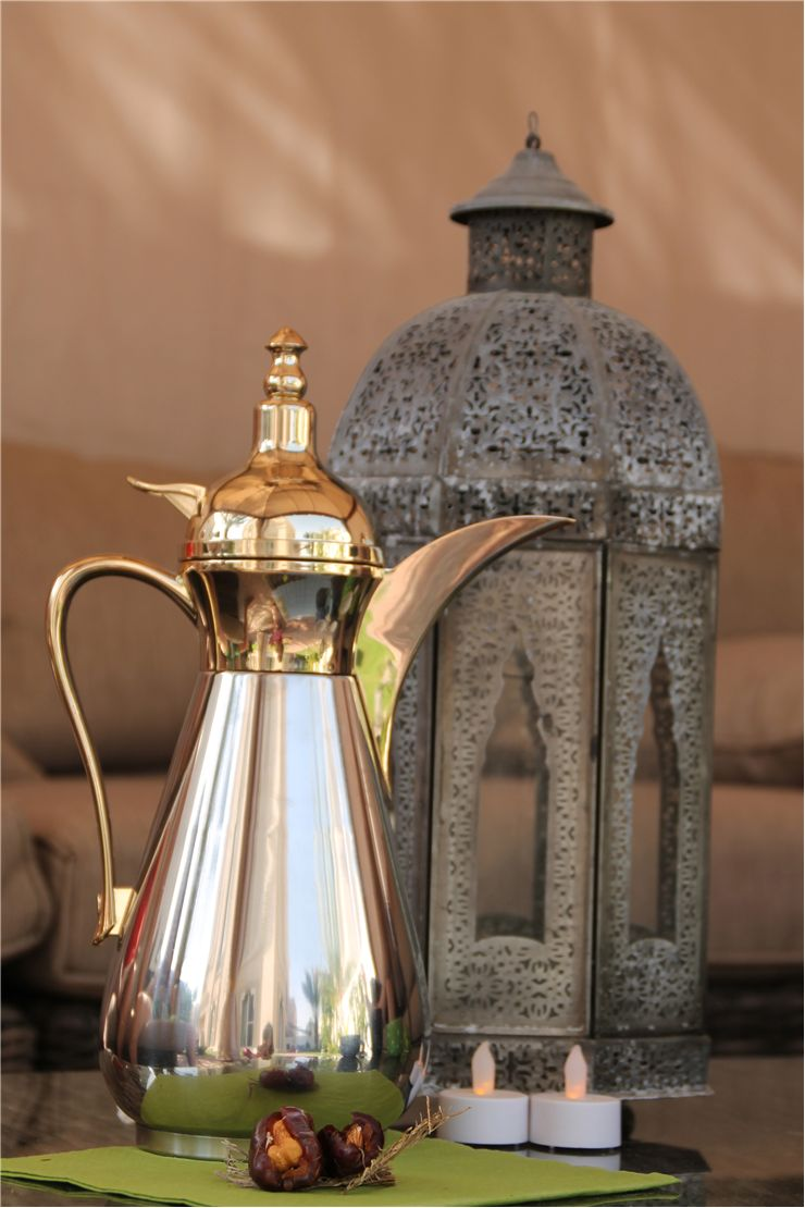 Picture Of Arabic Coffee In A Traditional Dallah With Dates