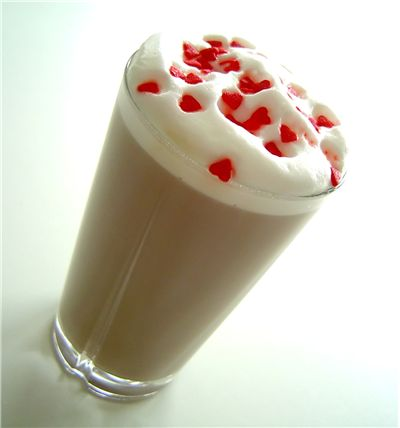 Picture Of Cafe Latte With Cream And Red Hearts
