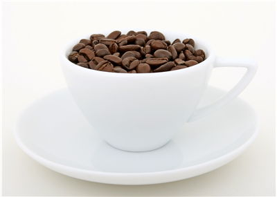 Picture Of Natural Coffee Beans And White Cup