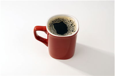 Picture Of Red Ceramic Coffee Mug With Black Coffee